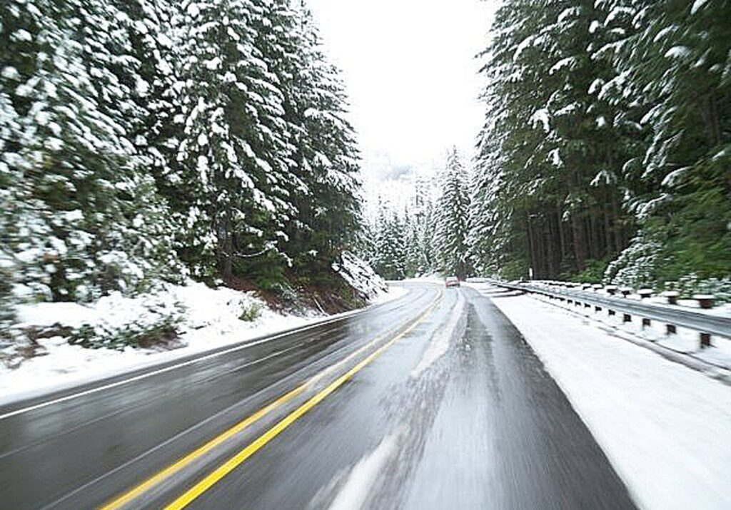 A highway is shown in the middle of winter.